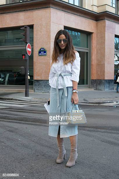 Fashion Blogger Tamara Kalinic wears a Suno skirt Dior sunglasses Stuart Weitzman boots Fendi bag on day 7 during Paris Fashion Week Autumn/Winter...
