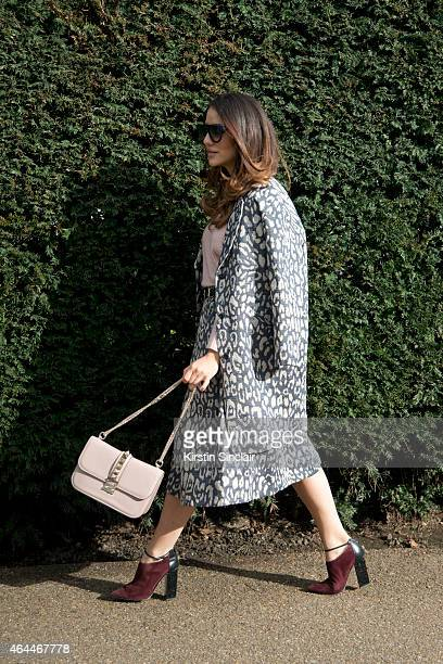 Fashion blogger Tamara Kalinic wears Iris and Ink coat and skirt Valentino bag Celine sunglasses Jimmy Choo shoes and 360 Cashmere sweater on day 4...