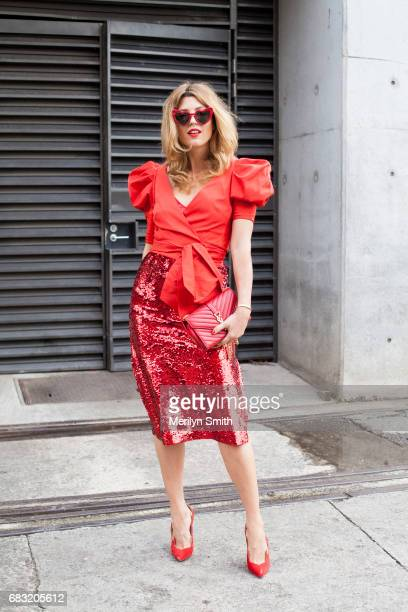 Fashion Blogger Tania Gesick is wearing a Kate Sylvester dress Kate Spade top Christian Louboutin shoes and YSL bag and sunglasses during...