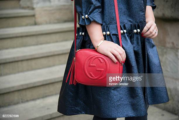 Fashion Blogger Tanya Burr wears an Osman coat and a Gucci bag day 4 of London Womens Fashion Week Spring/Summer 2016 on September 19 2016 in London...