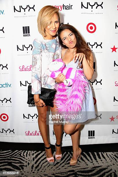 Fashion blogger Taye Hansberry and finalist Adelaine Morin attend NYX FACE Awards 2014 Presented by NYX Cosmetics at Club Nokia on August 22 2014 in...