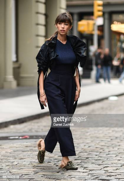 Fashion Blogger Thania Peck is seen in Soho wearing a Ferragamo jacket pants and top with Gucci loafers and a Prada bag on May 23 2017 in New York...