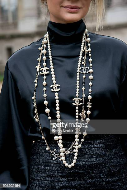 Fashion Blogger Thassia Naves wears a Chanel necklace skirt and shirt on day 8 during Paris Fashion Week Spring/Summer 2016/17 on October 6 2015 in...