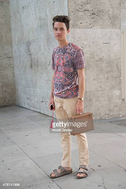Fashion blogger Thomas Reichegger wears Top Man shirt, Birkenstock shoes and vintage bag on day 3 of Paris Collections: Men on June 26, 2015 in...