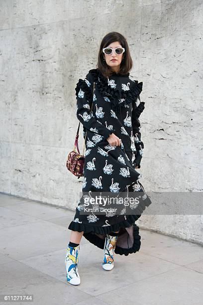 Fashion blogger Valentina Siragusa wears a Stella McCartney dress, Superretrofuture sunglasses and Jimmy Choo bag on day 2 of Paris Womens Fashion...