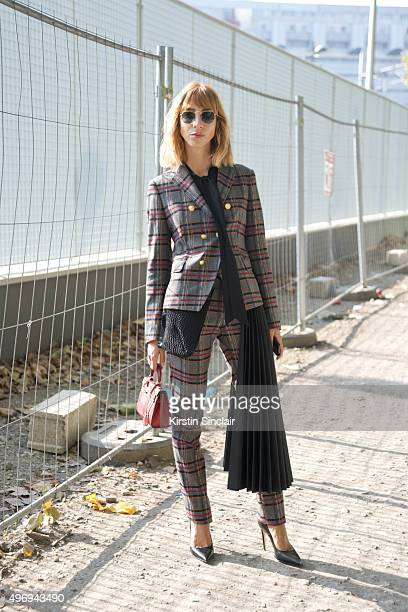 Fashion Blogger Veronica Giomini wears a Tagliatore suit Hermes bag Asos shoes and Rayban sunglasses on day 6 during Paris Fashion Week Spring/Summer...