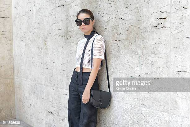 Fashion Blogger Virgine Leung wears a Diesel top Luisa Leitao sunglasses Chloe bag and Tailor made trousers on day 3 of Paris Collections Men on June...