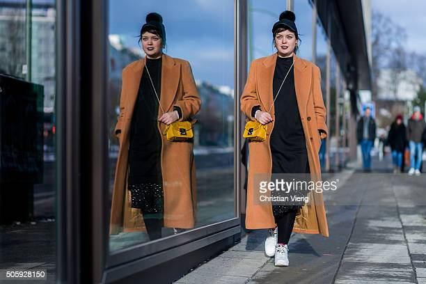 Fashion blogger Vreni Frost wearing coat Missoni bag Furla shoes air jordans nike cap river island during the MercedesBenz Fashion Week Berlin...