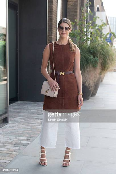 Fashion Blogger Wendy Gilmour wears an Iris and Ink at The Outnet dress H and M jeans Maison Scotch belt Reiss bag Chelsea Paris shoes and Tommy...