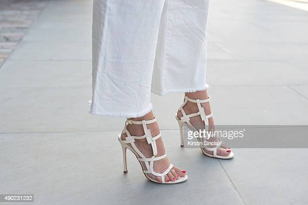 Fashion Blogger Wendy Gilmour wears H and M jeans and Chelsea Paris shoes on day 3 during London Fashion Week Spring/Summer 2016/17 on September 20...