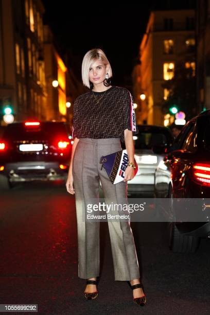 Fashion blogger Xenia Adonts is seen outside the Fendi cocktail #Fendimania on October 16 2018 in Paris France