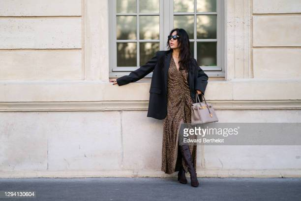Fashion blogger Xiayan wears sunglasses from Bottega Veneta, a black oversized blazer jacket from Les Coyotes de Paris, a brown gathered leopard...