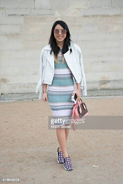 Fashion Blogger Yuyu wears a Pinko dress and shoes Fat Moose jacket Louis Vuitton bag and PRSR sunglasses on day 4 during Paris Fashion Week...