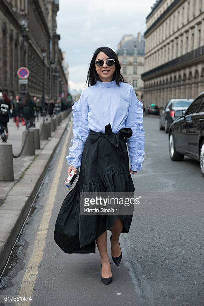 Fashion Blogger Yuyu wears a Pinko skirt Jimmy Choo shoes and a Store shirt on day 4 during Paris Fashion Week Autumn/Winter 2016/17 on March 4 2016...