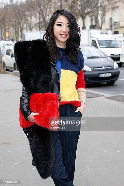 Fashion Blogger YUYU wears a Pipo Jumper Zara Handbag ans Stella Mc Cartney Shoes outside the 22/4 show on January 21 2015 in Paris France