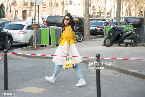 Fashion blogger Yuyu wears Awayvee jacket and dress and Nike shoes on day 3 of Paris Collections Women on March 05 2015 in Paris France
