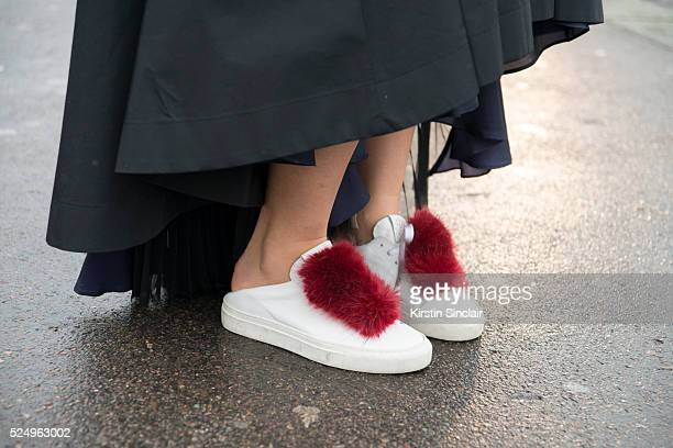 Fashion Blogger Yuyu Zhangzou wears a Sacai skirt and Pierre Hardy trainers on day 7 during Paris Fashion Week Autumn/Winter 2016/17 on March 7 2016...