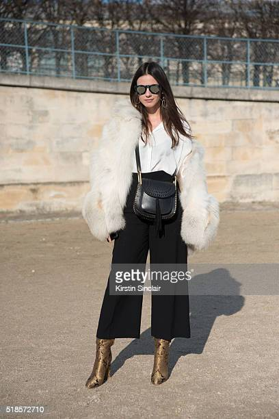 Fashion Blogger Zina Charkoplia wears a Chloe bag TopShop shirt Vintage fur Santoni shoes on day 5 during Paris Fashion Week Autumn/Winter 2016/17 on...