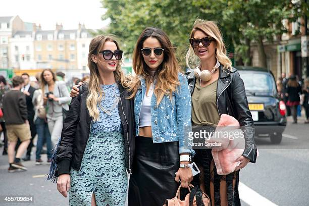 Fashion Bloggers Noor De Groot Tamara Kalinic and Zorana Jovanovic wearing Topshop on day 3 of London Collections Women on September 14 2014 in...