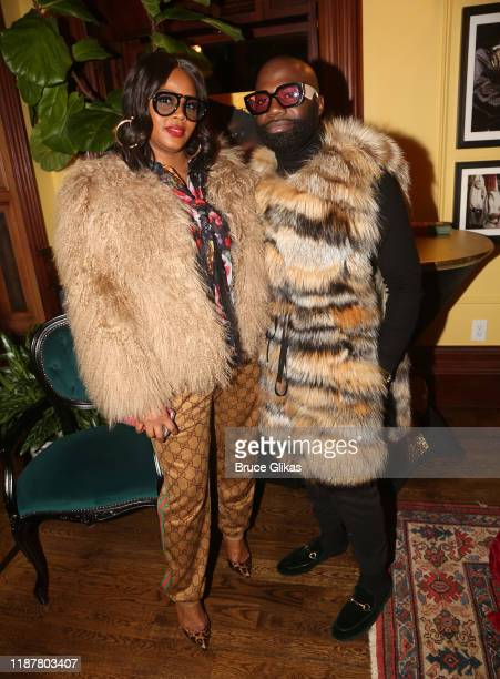 Fashion Bomb Daily's Claire Sulmers and Fur Designer Duckie Confetti pose at the celebration for the North of 40 Podcast Launch at Dapper Dan Atelier...
