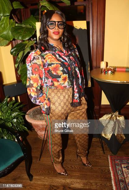 Fashion Bomb Daily's Claire Sulmers poses at the celebration for the North of 40 Podcast Launch at Dapper Dan Atelier on November 14 2019 in New York...