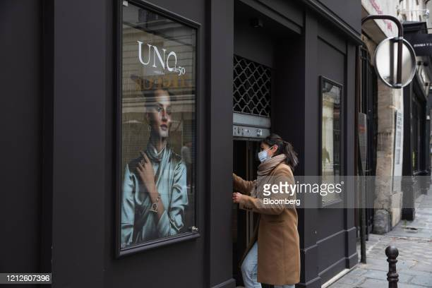 A fashion boutique owner opens her store as France enters a new phase of lockdown easing measures in Paris France on Monday May 11 2020 French Prime...