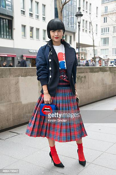 Fashion buyer and blogger Hilary Tsui wears all Toga and a Yasbukey bag on day 7 of Paris Collections Women on March 09 2015 in Paris France