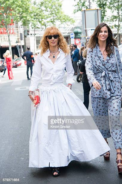 Fashion buyer and Kabuki boutique owner Elina Halimi wears Ray Ban sunglasses a Toni Maticevski skirt and a Sarahs bag bag day 4 of Paris Haute...