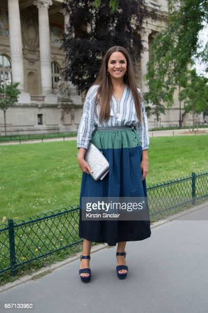 Fashion buyer and owner of The Webster fashion boutique Laure Heriard Dubreuil wears a Chanel bag and Celine shoes on day 3 of Paris Haute Couture...