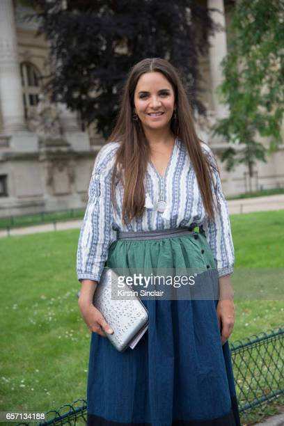 Fashion buyer and owner of The Webster fashion boutique Laure Heriard Dubreuil wears a Chanel bag on day 3 of Paris Haute Couture Fashion Week...