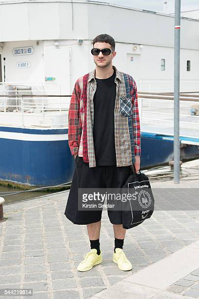 Fashion Buyer Calvin Holmes wears Nidels shirt Ralph Simons shoes and Saint Lauren sunglasses on day 1 of Paris Collections Men on June 22 2016 in...