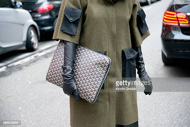 Fashion Buyer Diana Paolucci wears a Yang Li coat and a Goyard bag on day 5 of Paris Collections Women on March 01 2014 in Paris France