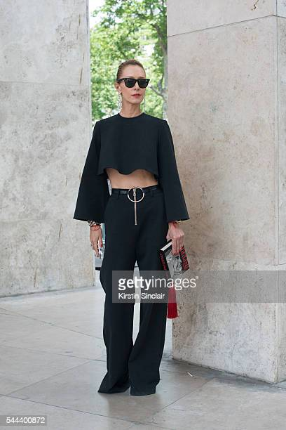 Fashion Buyer Elina Halimi wears a Beaufille top and trousers, Ray Ban sunglasses, Jennifer Fisher earrings and a Central Library clutch bag on day 3...