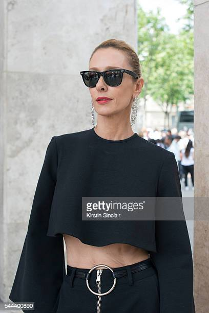 Fashion Buyer Elina Halimi wears a Beaufille top and trousers, Ray Ban sunglasses, Jennifer Fisher earrings on day 3 of Paris Collections: Men on...