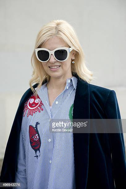 Fashion Buyer Eva Galambos wears a Balmain jacket Celine top and trousers and Dior sunglasses on day 6 during Paris Fashion Week Spring/Summer...
