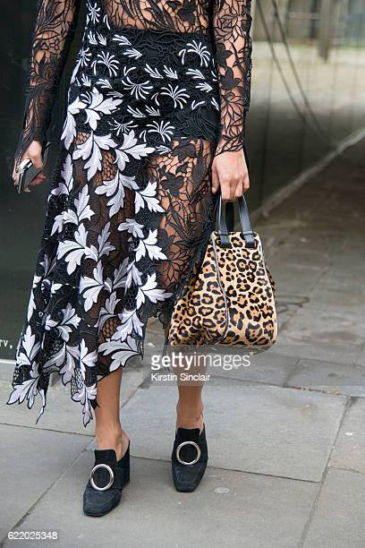 Fashion buyer for Feathers Tiffany Hsu wears a SelfPortrait dress Dorateymur shoes and a Loewe bag day 4 of London Womens Fashion Week Spring/Summer...