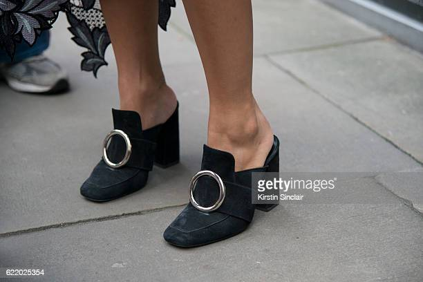 Fashion buyer for Feathers Tiffany Hsu wears Dorateymur shoes day 4 of London Womens Fashion Week Spring/Summer 2016 on September 19 2016 in London...