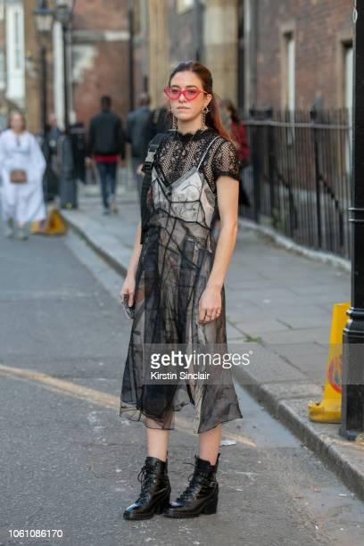 Fashion buyer for Selfridges Philippa Holden wears a Quersche dress Adam Selman sunglasses Prada bag and boots during London Fashion Week September...
