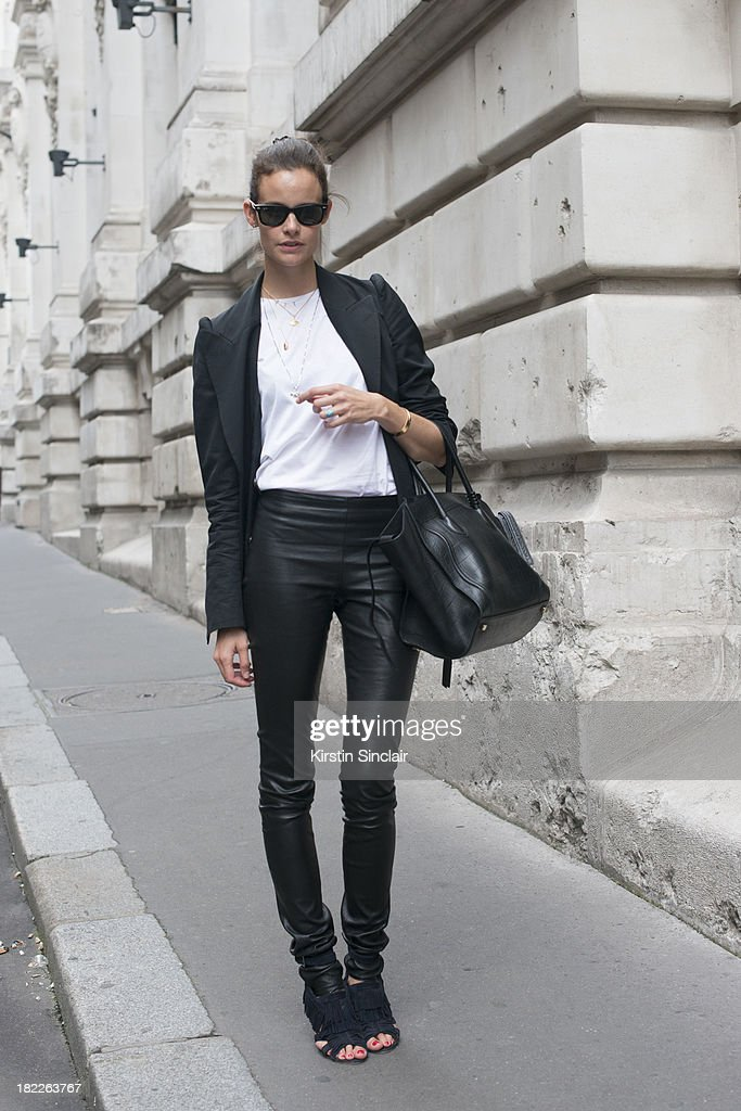 Fashion buyer for Soyouthinkyoucanshop.com Charlotte Collard wears Margiela jacket, Haider Ackermann trousers, Celine bag, Zara shoes, Celine D'Aoust jewellery and Ray Ban sunglasses on day 5 of Paris Fashion Week Spring/Summer 2014, Paris September 28, 2013 in Paris, France.