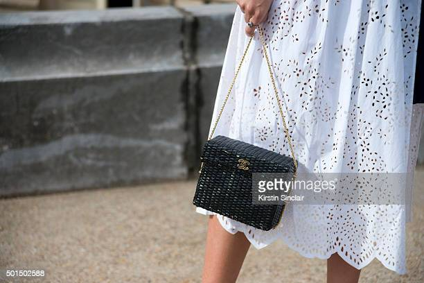 Fashion Buyer for The Gallerist Amanda Cassou wears a Sacai dress and Chanel bag on day 8 during Paris Fashion Week Spring/Summer 2016/17 on October...