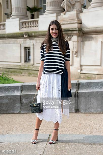 Fashion Buyer for The Gallerist Amanda Cassou wears Manolo Blahnik shoes Sacai dress Chanel bag and a vintage necklace on day 8 during Paris Fashion...