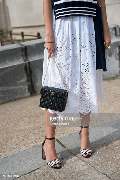 Fashion Buyer for The Gallerist Amanda Cassou wears Manolo Blahnik shoes Sacai dress and Chanel bag on day 8 during Paris Fashion Week Spring/Summer...