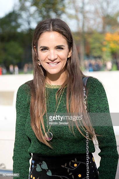 Fashion buyer for The Webster Laure HeriardDubreuil wears a Louis Vuitton bag and shoes Valentino skirt and top on day 9 during Paris Fashion Week...