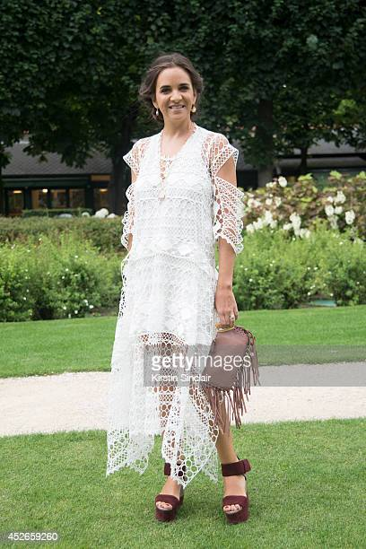Fashion buyer Laure Heriard Dubreuil wearing a Chloe dress day 2 of Paris Haute Couture Fashion Week Autumn/Winter 2014 on July 7 2014 in Paris France