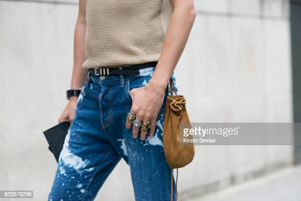 Fashion buyer Marco Lau wears an Astrid Anderson top Dsquared jeans Portel bag on day 3 of London Collections Men on June 11 2017 in Paris France