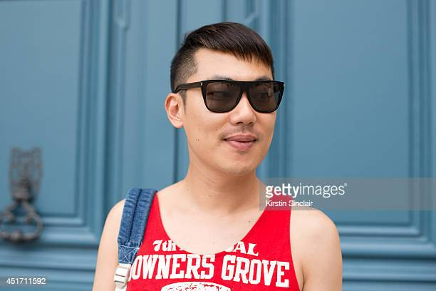 Fashion buyer Moki Cho wearing an Ameican Aparel bag and kemp top on day 3 of Paris Collections Men on JUNE 27 2014 in Paris France