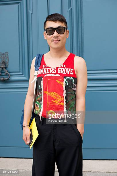 Fashion buyer Moki Cho wearing an Ameican Aparel bag trousers and top dress kemp on day 3 of Paris Collections Men on JUNE 27 2014 in Paris France