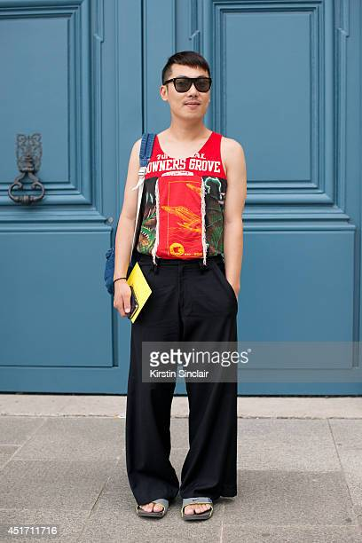 Fashion buyer Moki Cho wearing Nike sandals Ameican Aparel bag trousers and top kemp on day 3 of Paris Collections Men on JUNE 27 2014 in Paris France