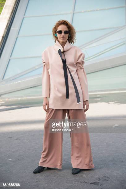 Fashion buyer Rubia Mala wears a Nous Etudions blouse, Elien trousers and Gucci sunglasses day 5 of Paris Womens Fashion Week Spring/Summer 2018, on...