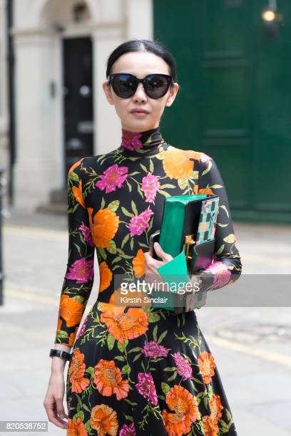 Fashion buyer Sherry Shen wears a Prada bag Celine sunglasses and a Balenciaga dress on day 3 of London Collections Men on June 11 2017 in Paris...